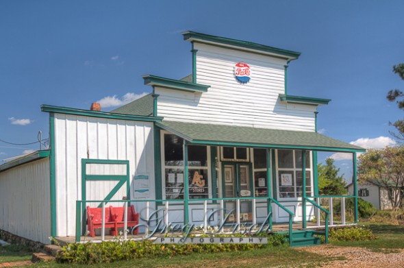 """The Red Oak General store built at the turn of the century in Red Oak Missouri has been operated by Lowell Davis's relatives since 1921.  The store was moved to Red Oak II and restored in 1988.  Red Oak II is the creation of artist Lowell Davis, who's family had pioneered the town of Red Oak.  After success as an artist, he started moving his old home town to his farm 32 miles away creating Red Oak II.  Lowell now lives in what he considers his """"Masterpiece"""" in the Belle Starr house where the famous outlaw was raised.  Red Oak II is located a few miles Northeast of Carthage Missouri, just off Route 66."""