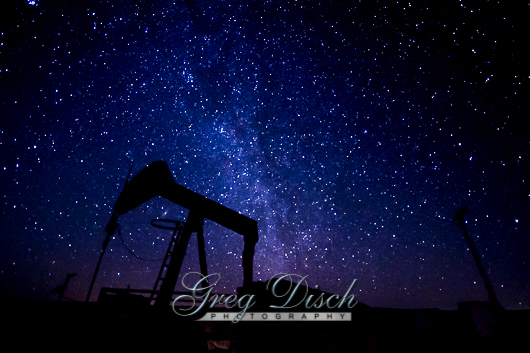 An oilwell with a background of stars in the Cimarron National Grassland near Elkhart Kansas.